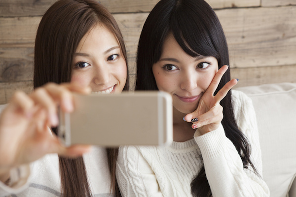 Two young women are taking a self shot